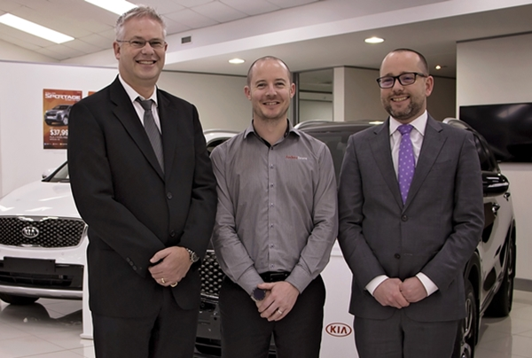 Travis Cross (centre) with Kia NZ GM, Todd McDonald, (left) and Andrew Simms Botany dealer principal, Matthew Wales (right) - PHOTO Christel Kelly Moore